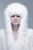 Pacific Islander woman wearing fur hood