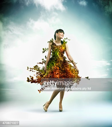 Pacific Islander woman wearing gown of plants