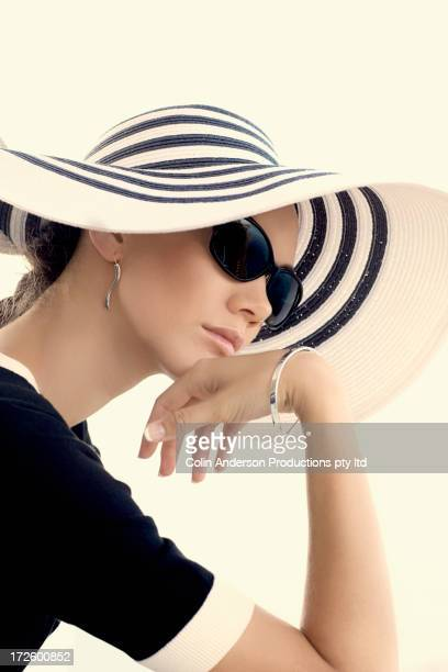 Pacific Islander woman wearing sunhat