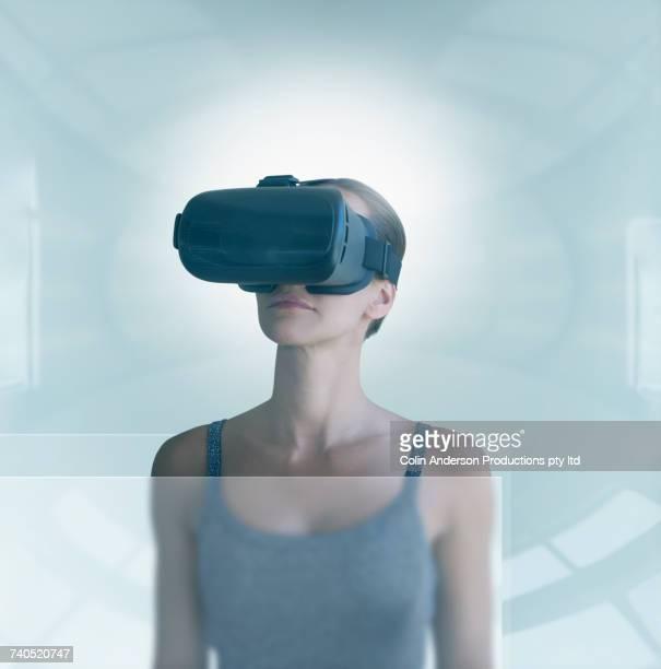 Pacific Islander woman wearing virtual reality goggles