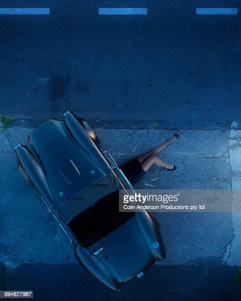 Pacific Islander woman working on broken down car