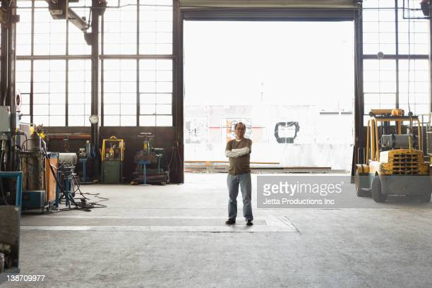Pacific Islander worker standing in warehouse