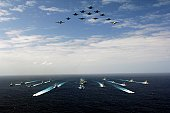 Pacific Ocean (November 14, 2006) - Aircraft assigned to Carrier Air Wing Five (CVW-5) fly over a group of 18 U.S. and Japanese Maritime Self-Defense Force ships, at the conclusion the two nations' exercise ANNUALEX.
