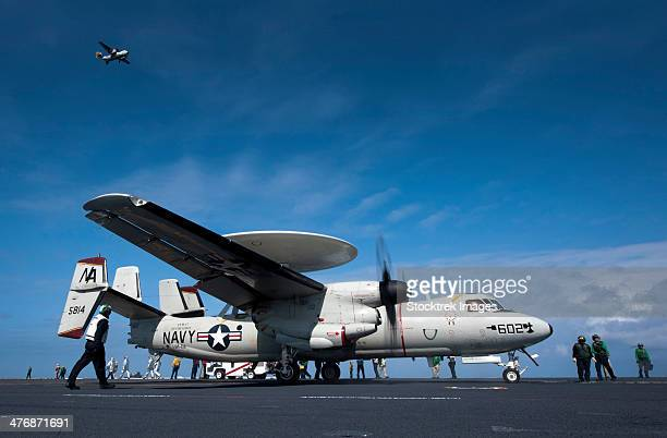 Pacific Ocean, April 24, 2013 - An E-2C Hawkeye prepares to launch from the flight deck aboard the aircraft carrier USS Carl Vinson.