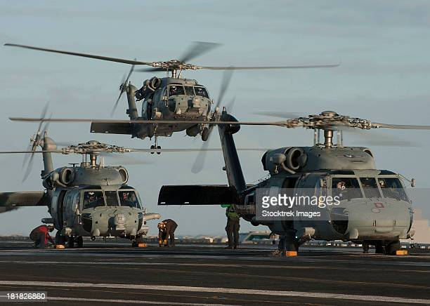 Pacific Ocean, December 21, 2011 - SH-60F and HH-60H Sea Hawk helicopters land on the flight deck aboard the Nimitz-class aircraft carrier USS Carl Vinson.