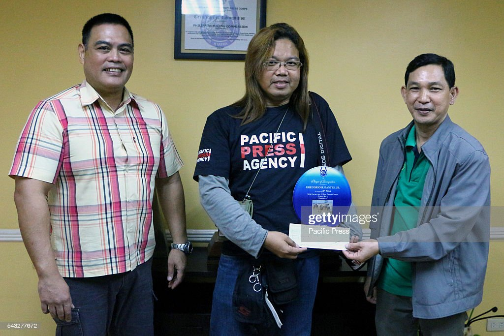 Pacific Press Agency photographer Gregorio B. Dantes Jr. (center) receiving his 3rd place award from Philracom (Philippine Racing Commission) Commissioner Lyndon Guce (right) and to Philracom (Philippine Racing Commission) Director Andrew M. Buencamino at the head office in Makati City for the 2016 PHILRACOM 1st Leg Triple Crown Stakes Horse Race Photojournalist Photo Contest.