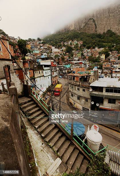 A 'pacified' favela or squatter settlement is seen in the mist beneath forest on June 21 2012 in Rio de Janeiro Brazil Rio de Janiero's authorities...