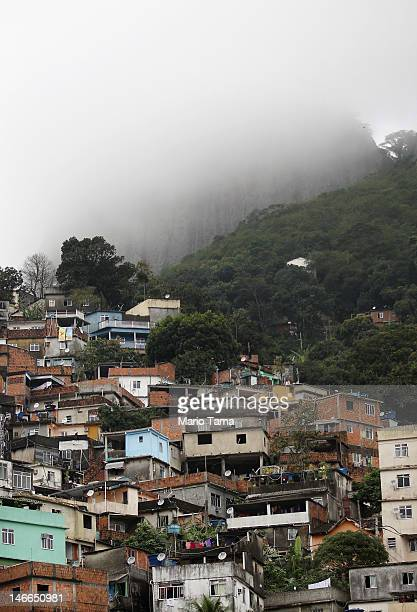 A 'pacified' favela or squatter settlement is seen in the mist on a forested mountainside on June 21 2012 in Rio de Janeiro Brazil Rio de Janiero's...