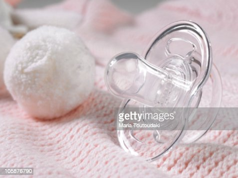 Pacifier on pink baby bodysuit