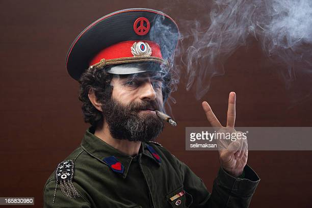 Pacifist general in military officier uniform making peace sign