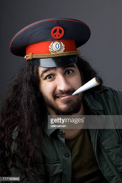 Pacifist man with military officier hat smoking pot