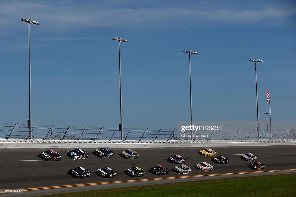 A pack of cars draft during during NASCAR Sprint Cup Series Preseason Thunder testing at Daytona International Speedway on January 11, 2013 in Daytona Beach, Florida.