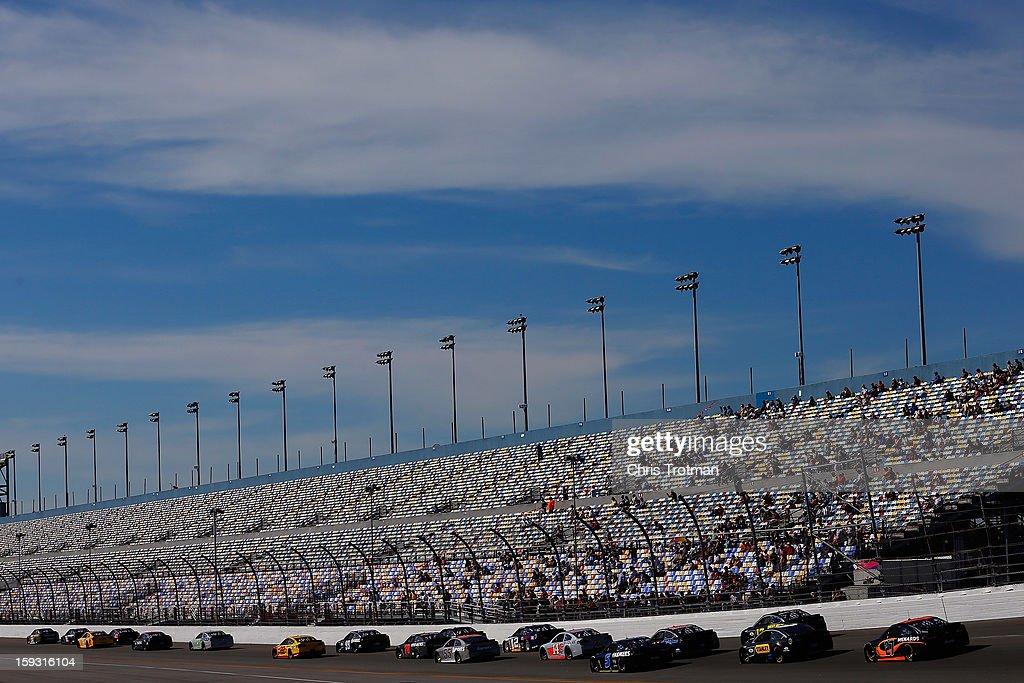 A pack of cars draft during during NASCAR Sprint Cup Series Preseason Thunder testing at Daytona International Speedway on January 11, 2013 in Daytona Beach, Florida.