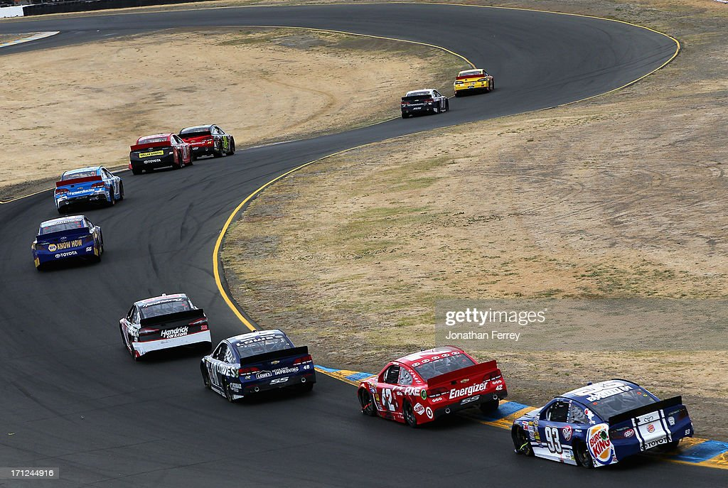 A pack of cars drives during the NASCAR Sprint Cup Series Toyota/Save Mart 350 at Sonoma Raceway on June 23, 2013 in Sonoma, California.
