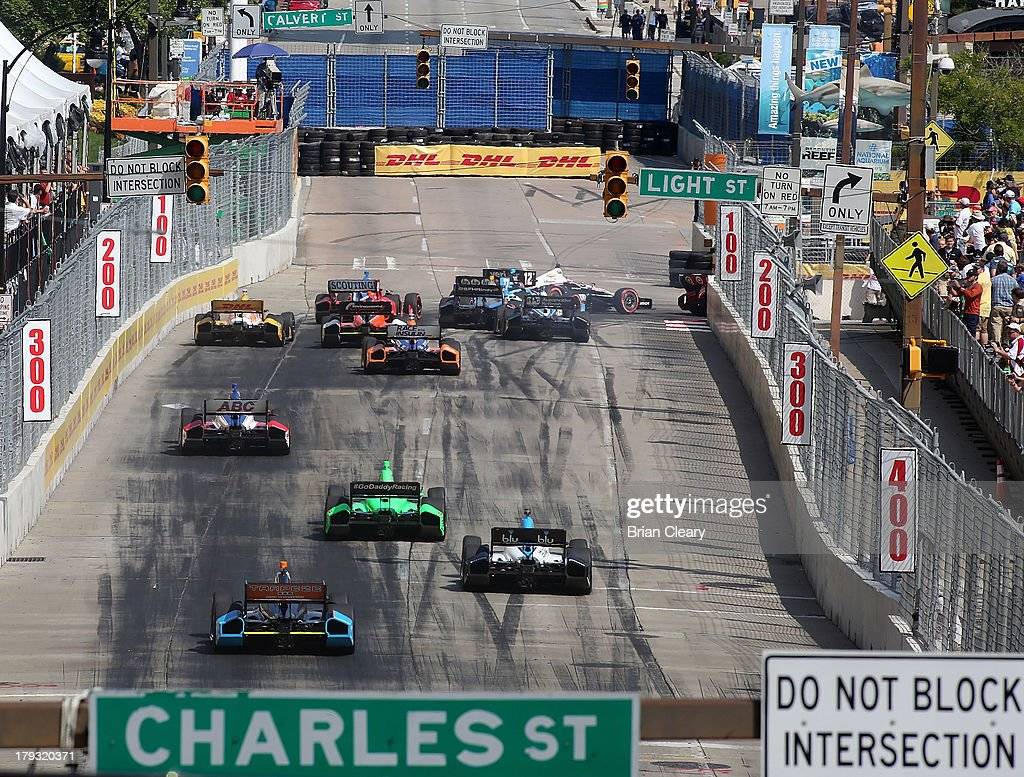 A pack of cars races into turn one at the start of the Grand Prix of Baltimore on September 1, 2013 in Baltimore, Maryland.