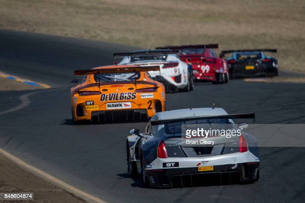 A pack of cars races through a turn during the GoPro Grand Prix of Sonoma GT race at Sonoma Raceway on September 17 2017 in Sonoma California