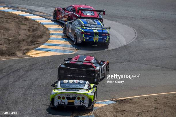 A pack of cars races through the chicane during the GoPro Grand Prix of Sonoma GTS race at Sonoma Raceway on September 17 2017 in Sonoma California