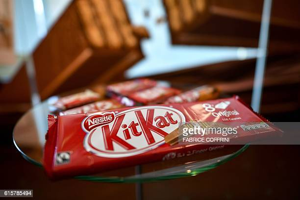 A pack of chocolatecovered wafer biscuit bar KitKat brand is displayed in the showroom of Swiss food giant's Nestle on October 20 2016 in Vevey Sales...