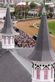 A pack of horses rounds the final bend as seen through the twin spires during the 3rd race ahead of the 140th Kentucky Oaks at Churchill Downs on May...