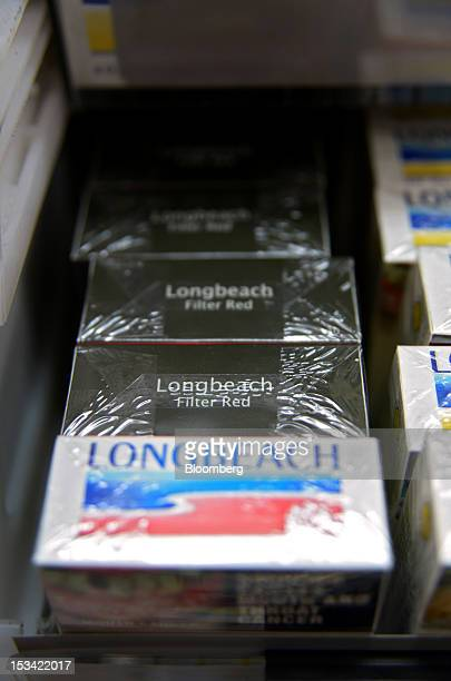 A pack of Philip Morris International Inc Longbeach cigarettes in the old packaging front is arranged for a photograph with packs in the new...