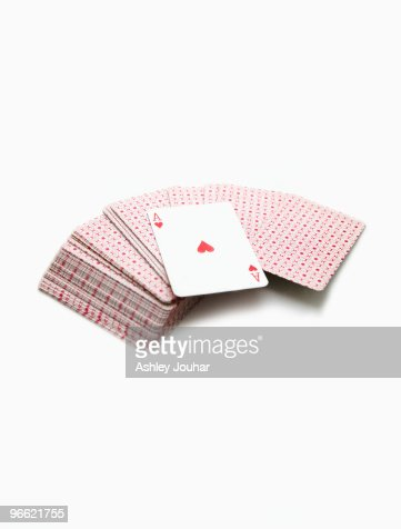 Pack of playing cards, showing the ace of hearts : Stock Photo