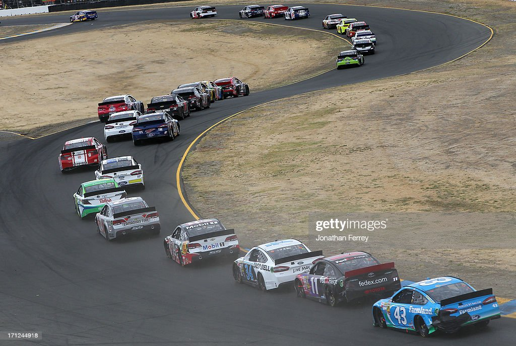 A pack oif cars races during the NASCAR Sprint Cup Series Toyota/Save Mart 350 at Sonoma Raceway on June 23, 2013 in Sonoma, California.