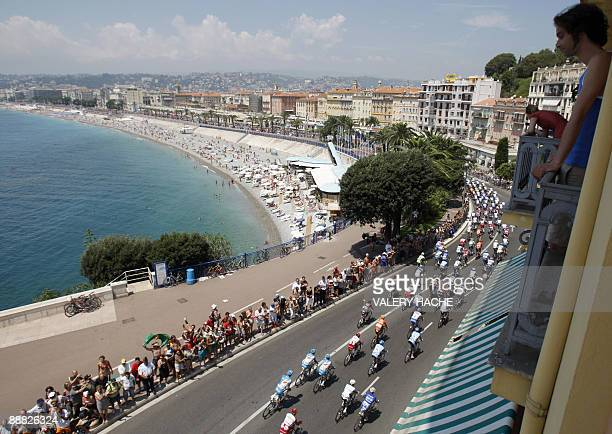 A pack rides at the 'Promenade des Anglais' in Nice southern France during the 182 km second stage of the 2009 Tour de France cycling race Monaco and...