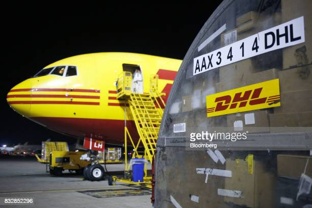 A package container next to a DHL Worldwide Express cargo jet at the company's hub of Cincinnati/Northern Kentucky International Airport in Hebron...