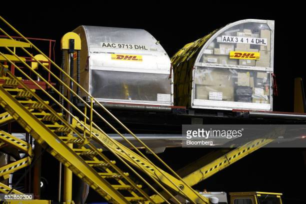 Package containers are unloaded from a DHL Worldwide Express cargo jet at the company's hub of Cincinnati/Northern Kentucky International Airport in...