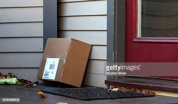 A package is pictured on the deck of a home on Putnam Avenue in Cambridge MA on Nov 22 2016