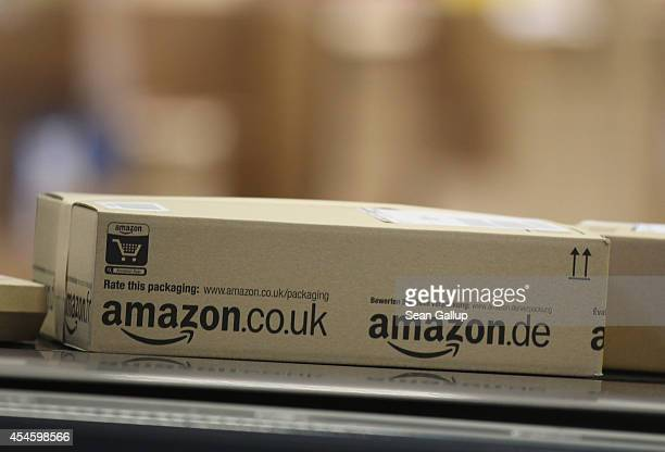 A package moves on a conveyor belt at an Amazon warehouse on September 4 2014 in Brieselang Germany Germany is online retailer Amazon's second...