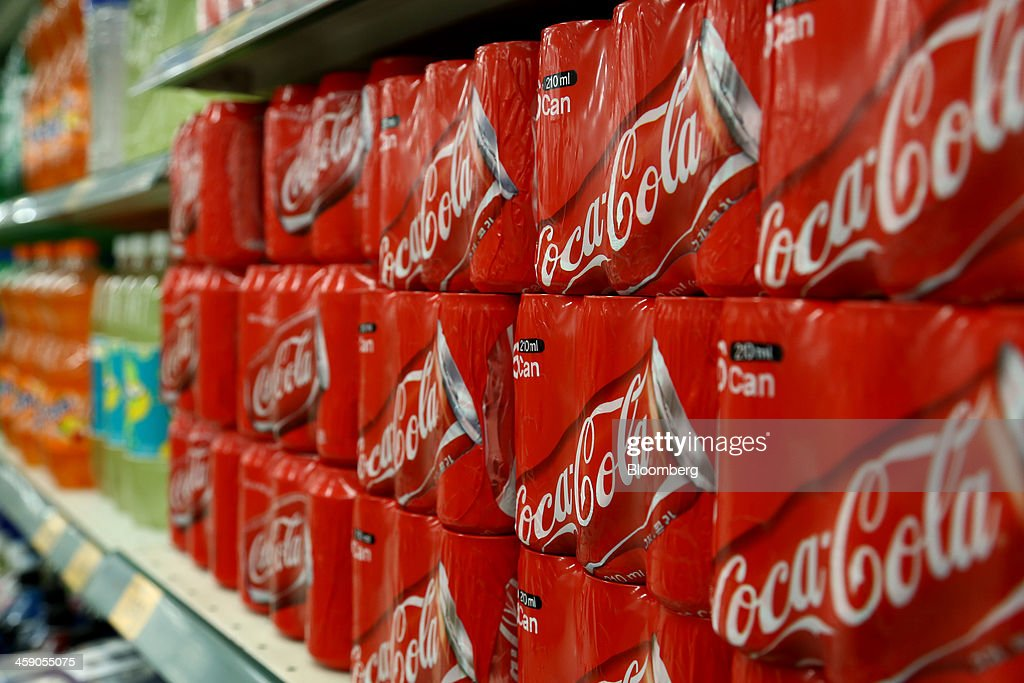 Packaged cans of Coca-Cola Co. soda are displayed for sale at an E-Mart Co. store, a subsidiary of Shinsegae Co., in Incheon, South Korea, on Saturday, Dec. 21, 2013. Consumer prices climbed 0.9 percent in November from a year earlier after a 0.7 percent increase in October that was the smallest gain since July 1999. Photographer: SeongJoon Cho/Bloomberg via Getty Images