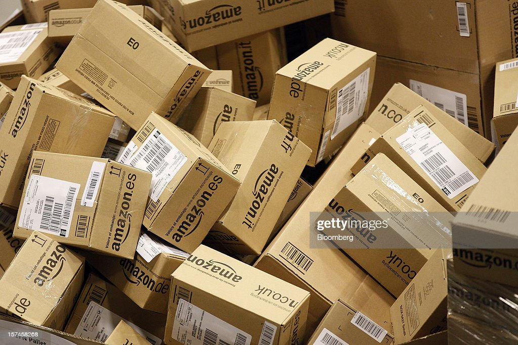Packaged customer orders await delivery from the Amazon.co.uk Marston Gate 'Fulfillment Center'' the U.K. site of Amazon.com Inc. in Ridgmont, U.K., on Monday, Dec. 3, 2012. U.K. consumer confidence unexpectedly increased to an 18-month high in November as Britons become more optimistic about the economy and their finances, GfK NOP Ltd. said. Photographer: Simon Dawson/Bloomberg via Getty Images