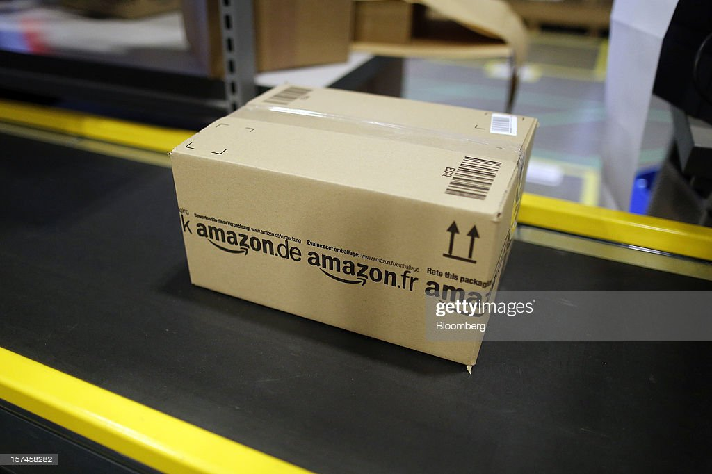 A packaged customer's orders travels along a conveyor belt at the Amazon.co.uk Marston Gate 'Fulfillment Center,' the U.K. site of Amazon.com Inc. in Ridgmont, U.K., on Monday, Dec. 3, 2012. U.K. consumer confidence unexpectedly increased to an 18-month high in November as Britons become more optimistic about the economy and their finances, GfK NOP Ltd. said. Photographer: Simon Dawson/Bloomberg via Getty Images