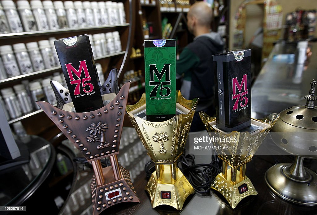 Packaged M75 perfume bottles are displayed at the 'Stay Stylish' shop in Gaza City on December 10, 2012. 'Victory' has never smelled so sweet -- or at least that's what they would have you believe at the shop selling Gaza's newest fragrance named M75 after a long-range Hamas rocket.