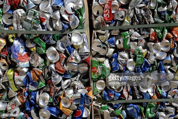 Packaged metal canes are seen at a waste treatment plant in the area of Monteverde east of Beirut on October 27 2017 The Lebanese divers plunge below...