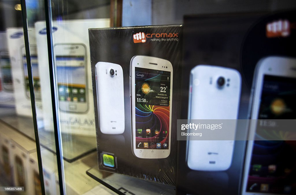 Packaged Micromax Informatics Ltd. and Samsung Electronics Co. smartphones are displayed on the shelves of a multi-brand smartphone store in New Delhi, India, on Tuesday, April 9, 2013. Apple Inc. and Samsung Electronics Co. are being outpaced in the fast-growing Indian smartphone market by aggressive local competitors Micromax and Karbonn Mobiles India Pvt. Ltd. Photographer: Prashanth Vishwanathan/Bloomberg via Getty Images