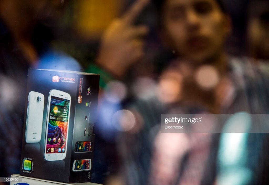 A packaged Micromax Informatics Ltd. Canvas 2 smartphone is displayed at a wholesale mobile outlet at Gaffar Market in New Delhi, India, on Tuesday, April 9, 2013. Apple Inc. and Samsung Electronics Co. are being outpaced in the fast-growing Indian smartphone market by aggressive local competitors Micromax and Karbonn Mobiles India Pvt. Ltd. Photographer: Prashanth Vishwanathan/Bloomberg via Getty Images