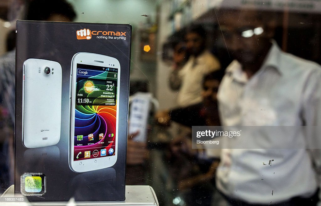 A packaged Micromax Informatics Ltd. smartphone is displayed in a shop window at a wholesale smartphone outlet at Gaffar Market in New Delhi, India, on Tuesday, April 9, 2013. Apple Inc. and Samsung Electronics Co. are being outpaced in the fast-growing Indian smartphone market by aggressive local competitors Micromax and Karbonn Mobiles India Pvt. Ltd. Photographer: Prashanth Vishwanathan/Bloomberg via Getty Images