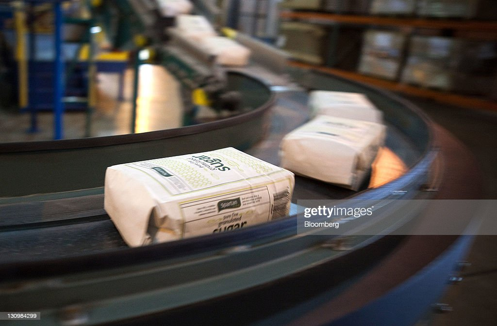 Packaged white sugar moves on a conveyer line before being placed on a pallet and delivered to a retailer at the Michigan Sugar Co. plant in Bay City, Michigan, U.S., on Monday, Oct. 24, 2011. U.S. sugar supplies this year will fall to the lowest since record-keeping began in 1960 as consumption rises and a smaller beet crop limits supplies left from last season, according to a U.S. Department of Agriculture report released earlier this month. Photographer: Adam Bird/Bloomberg via Getty Images