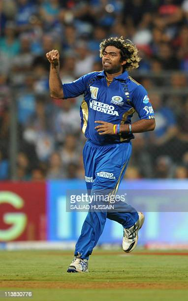Mumbai Indians cricketer Lasith Malinga celebrates after teammate Harbhajan Singh dismissed Delhi Daredevils batsman Yogesh Nagar during the IPL...