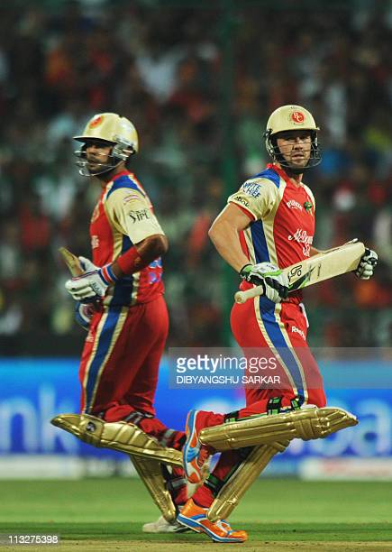 PACKAGERoyal Challengers Bangalore batsman AB de Villiers and Virat Kohli run between wickets during the IPL Twenty20 match between Pune Warriors and...