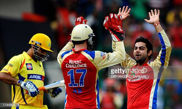 PACKAGERoyal Challengers Bangalore bowler Virat Kohli celebrates with teammate AB De Villiers after taking the wicket of Chennai Super Kings batsman...