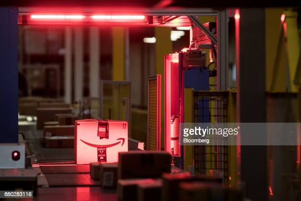Packages are scanned while moving along a conveyor belt at the Amazoncom Inc fulfillment center in Robbinsville New Jersey US on Monday Nov 27 2017...