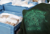 Packages containing confiscated cocaine are seen at a press conference on March 4 2012 in Hamburg Germany Agents seized 260 kg of cocaine aboard the...