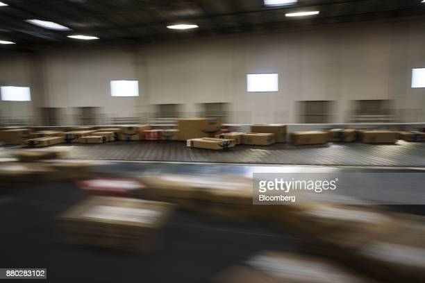 Packages move along a conveyer belt at the Amazoncom Inc fulfillment center in Robbinsville New Jersey US on Monday Nov 27 2017 The holiday shopping...