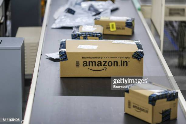 Packages move along a conveyor belt at the Amazoncom Inc fulfillment center in Hyderabad India on Thursday Sept 7 2017 Amazon opened its largest...