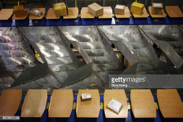 Packages move down conveyor belts while being sorted at the DHL Worldwide Express hub of Cincinnati/Northern Kentucky International Airport in Hebron...