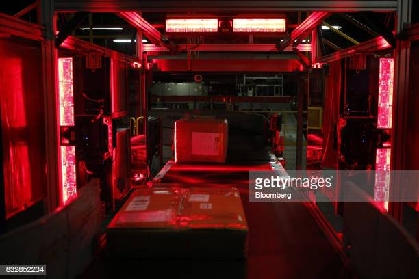 Packages move through laser beams while being sorted at the DHL Worldwide Express hub of Cincinnati/Northern Kentucky International Airport in Hebron...