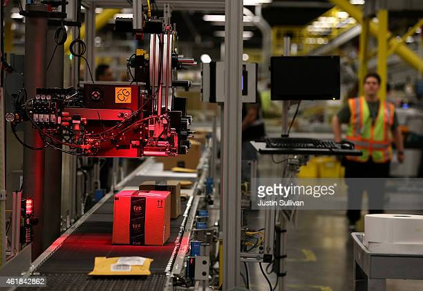 Packages move trough a labeling machine at an Amazon fulfillment center on January 20 2015 in Tracy California Amazon officially opened its new 12...